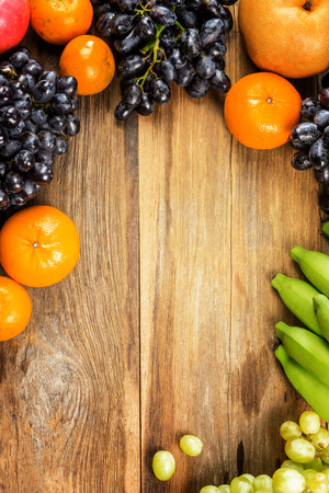 Studio Shot of Healthy eating ,different fruits on old wooden table photo