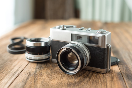 cameras: Old retro Film camera on wooden background that had been popular in the past Stock Photo