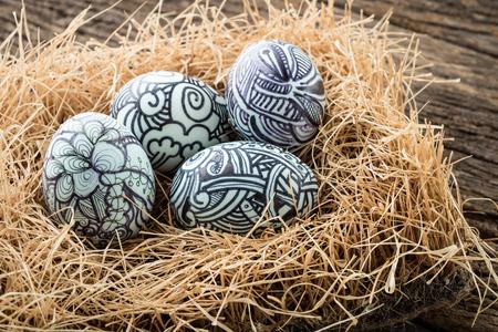 studio shot: Nest with Easter eggs on the wooden background,Studio Shot