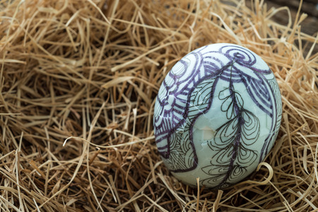 cracked egg: Nest with Easter eggs on the wooden background,Studio Shot ,one cracked egg