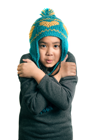 portrait of adorable happy child cold girl in warm hat , isolated on white