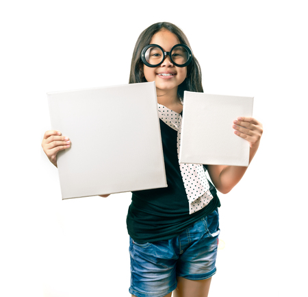 white board: Portrait of smiling asian  pretty girl holding black board on white background isolated white at the studio.