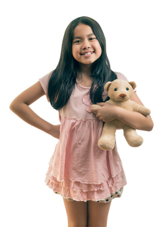 the favourite: Cute girl playing together with her favourite doll, ,isolated on white, This has clipping path.