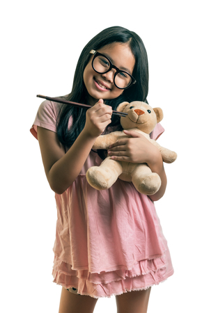 the favourite: Cute girl playing together with her favourite doll,isolated on white, This has clipping path.