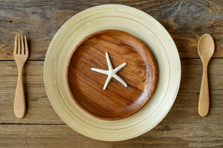 star fish: The brown wooden bowl on a rustic table with Star fish ,wooden background, Top View