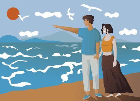 happy couple walking along a beach