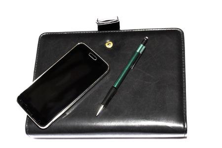 notieren: Terminkalender mit Stift uns Smartphone