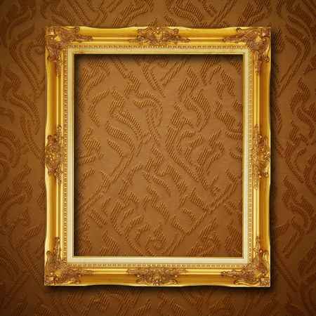 golden frame on vintage wallpaper photo