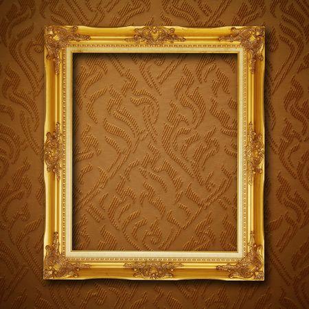 golden frame on vintage wallpaper