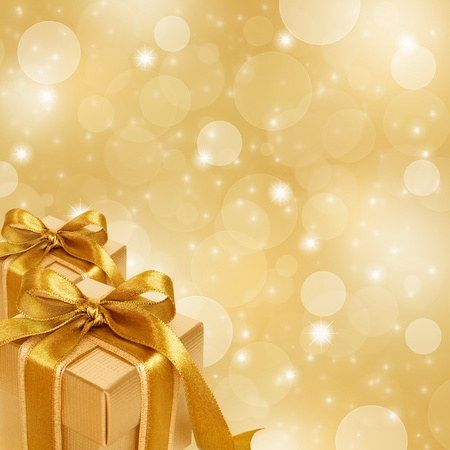 gold gift box on abstract gold Christmas background Stok Fotoğraf