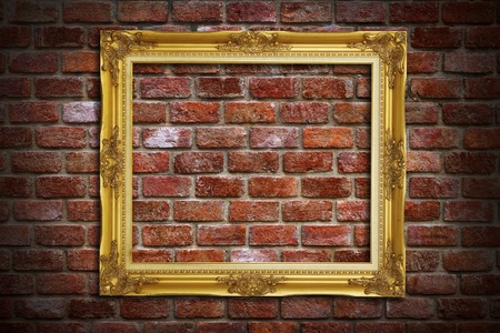 Gold frame on old brick wall background photo