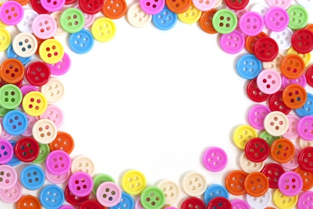 craft button: Multi color buttons on white background with copy space