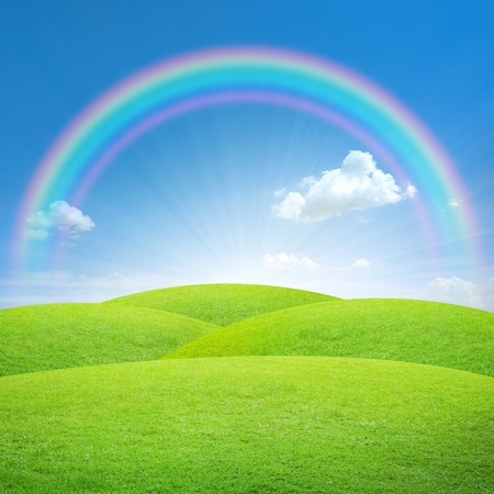 Green field with blue sky and perfect rainbow Stok Fotoğraf