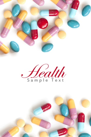 Colorful pill tablets on white background with copy space