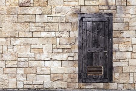 Old Wooden Door on Grunge Brick Wall photo