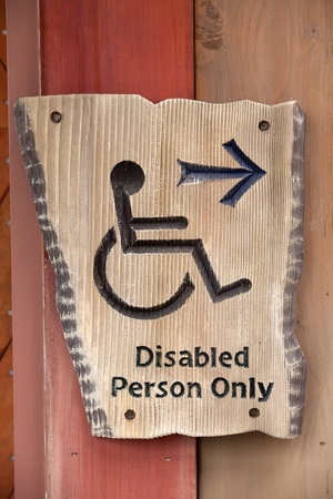 capable: A handicapped sign on wood wall