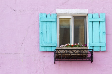 old building facade: blue window on the pink wall with space