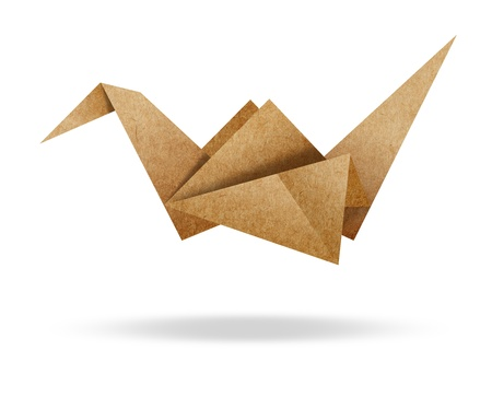 Origami Bird from Brown paper cardboard on white background photo