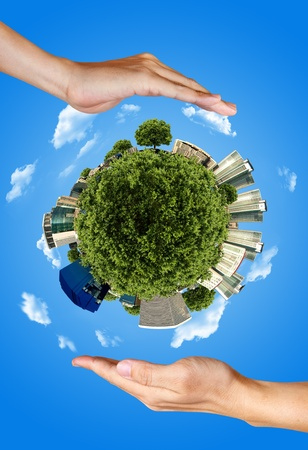 house warming: two hands saving the earth