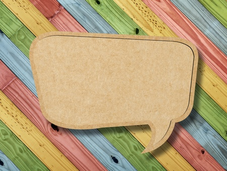 Blank Speech Bubble on colorful painting wood background photo