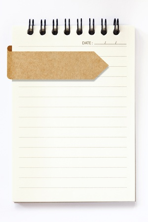bulletin board: blank notebook with blank recycle paper label on white background