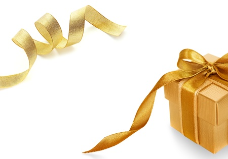 Gold gift box on white  background with Shiny gold satin ribbon on white background Stock Photo