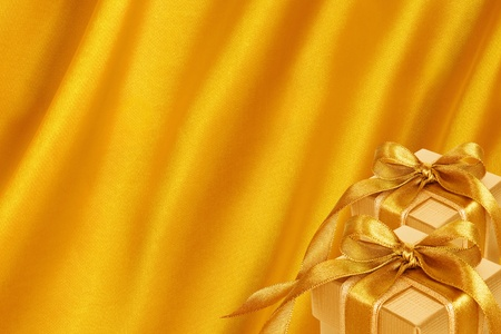 Gold Gift Box on gold satin background photo