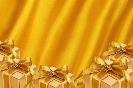 shiny gold: Gold Gift Box on gold satin background