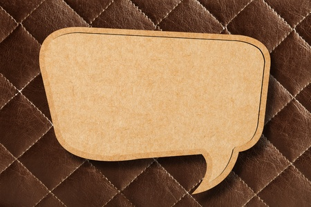 leather stitch: Blank Speech Bubble on Brown leather Background
