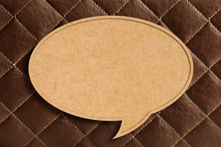 Blank Speech Bubble on Brown leather Background photo