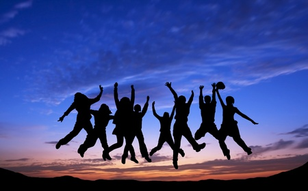 Crowd of friends jumping on blue sky background