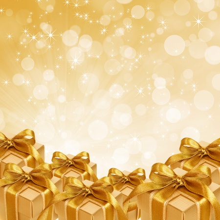 gold gift box on abstract gold Christmas background Stok Fotoğraf - 10651563