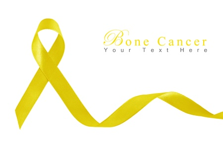 Yellow Ribbon a Symbol of Bone Cancer with copy space Stock Photo
