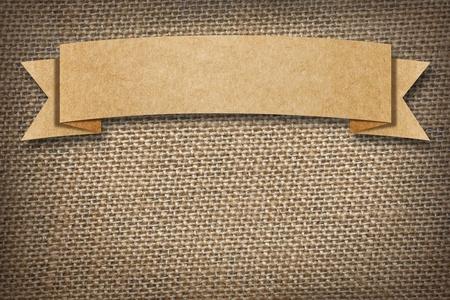 Cardboard Label on burlap background with space  Stok Fotoğraf