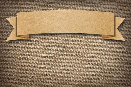 burlap: Cardboard Label on burlap background with space  Stock Photo