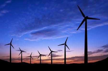 turbin: Silhuett av vindkraftverk på solnedgången bakgrund med utrymme Stockfoto