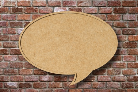 Recycle paper speech bubble on old brick wall background photo
