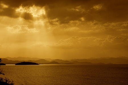 Rays of sun shining through the clouds over the Lake photo