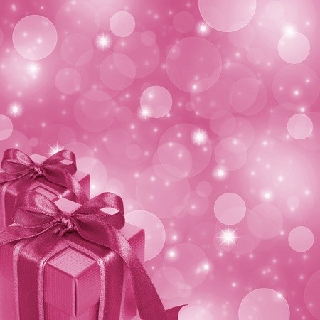 Pink gift boxes on abstract pink glitter background photo