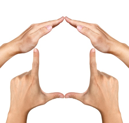 house in hand: human hands made house shape Stock Photo