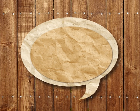 Blank Speech Bubble on wood background photo