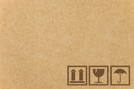 Safety fragile icon on cardboard paper box with space