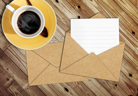 blank letter with the envelope on coffee table photo