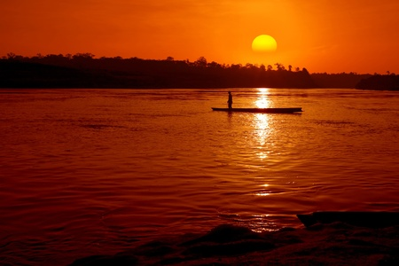 Fisher boat in the river with sunset  photo
