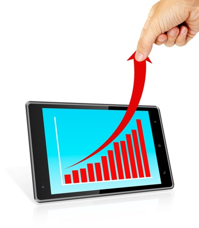 Human hand pulling up red arrow from a bar graph in a tablet computer photo