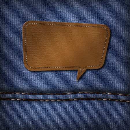 sewed: Blank leather jeans label in speech bubble shape on a blue jeans background