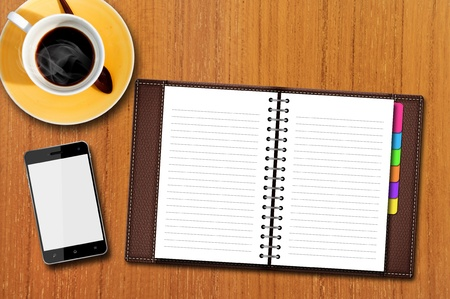 Personal Organizer and Smart Phone on Wood Table Stok Fotoğraf