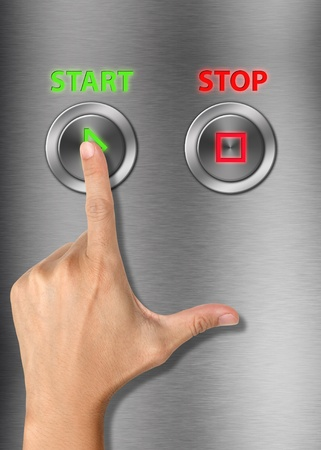 Human hand pressing start button on metalic background Stock Photo - 13659096