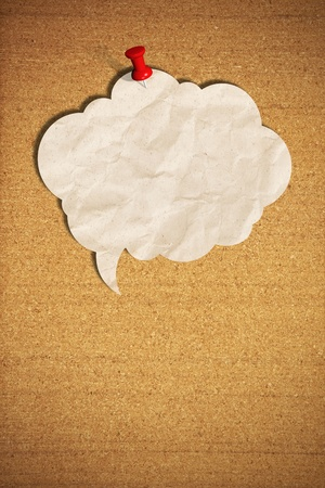 blank speech bubble note paper with push pins on cork board Stock Photo - 14796129