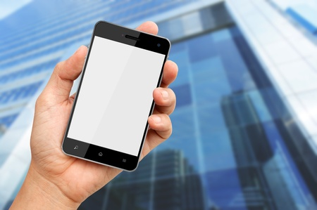 buiding: Hand holding blank screen smart phone with buiding background